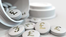 Close-up shot of pills with stamped pound sterling GBP symbol on them. Expensive drugs or financial remedy conceptual 3D royalty free stock image