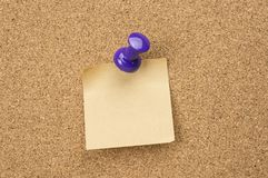 Cork board with pinned note Royalty Free Stock Photo