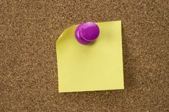 Cork board with pinned note Royalty Free Stock Image