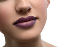 Close up shot of plump sexy female lips covered with lipstick Stock Images