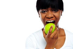 Close up shot pretty lady eating green apple Royalty Free Stock Photos