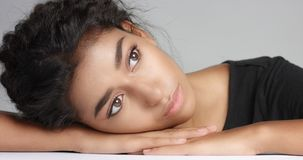 Close up shot of a pretty young wooman with smooth glowing skin relaxing on a white massage table. Stock Photography