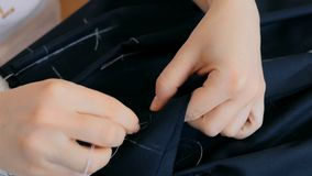 Close up shot. Professional tailor, fashion designer working at sewing studio Royalty Free Stock Image