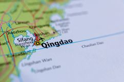 Qingdao on map. Close up shot of Qingdao. Tsingtao. is a city in eastern Shandong Province on the east coast of China Stock Images