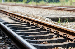 Close up shot of railway track. Old used railway track shot from the ground Stock Photos
