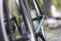 Close-up shot of rear wheel of a bicycle. Close-up shot of rear wheel of a bicycle with bokeh background royalty free stock photography