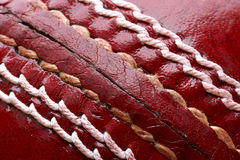 Close up shot of a red cricket ball. Horizontal royalty free stock images