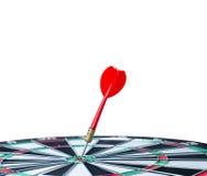 Close up shot red dart arrow on center of dartboard, metaphor to Stock Photo