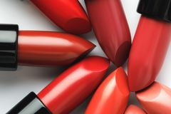 Close-up shot of red lipsticks of different shades. On white tabletop Stock Photography