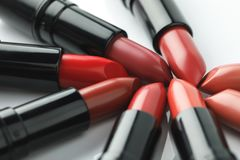 Close-up shot of red lipsticks of various shades. On white tabletop Stock Images