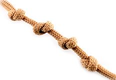 Close up shot of a rope with a four knots isolated Stock Photo