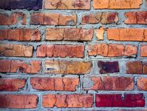A close-up shot of a rough brick masonry wall lined with red clumsy brick for creativity, textures and background. Stock Photography