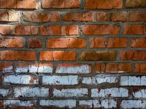 A close-up shot of a rough brick masonry wall lined with red clumsy brick for creativity, textures and background. Stock Photo