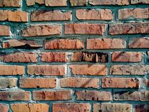 A close-up shot of a rough brick masonry wall lined with red clumsy brick for creativity, textures and background. Stock Images