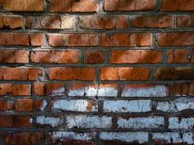 A close-up shot of a rough brick masonry wall lined with red clumsy brick for creativity, textures and background. Stock Photos