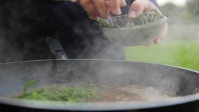 Sea beans on boiling sauce. A close up shot of sea beans put into a pan with hot sauce boiling stock footage