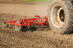 Close up shot of seedbed cultivator machine at work. Royalty Free Stock Image