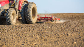 Close up shot of seedbed cultivator machine at work Royalty Free Stock Image