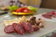 Serbian breakfast with sliced domestic sausage, bacon, ham and cheese. Close up shot of Serbian breakfast with sliced domestic sausage, bacon, ham and cheese royalty free stock photography