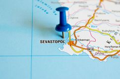 Sevastopol on map. Close up shot of Sevastopol on map with blue push pin stock photos