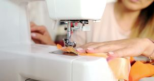 Close up shot of sewing machine stock footage