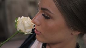 Close-up shot of woman lips with lipstick and beautiful white rose sensual stock footage