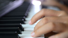 Close up shot shallow depth of field hands of woman playing piano keyboard press on black and white key stock video footage