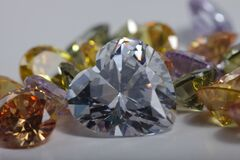 Close up shot of shiny heart shaped and colored crystal zirconia diamond beads