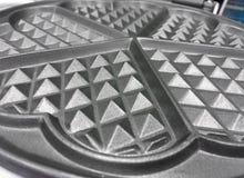 A close up shot of a silver waffle iron texture stock photos
