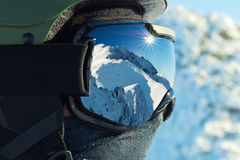 Close up shot of ski goggles with reflection of snowed mountains in it Royalty Free Stock Photography