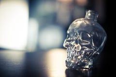 Skull shaped crystal bottle. Close up shot of a skull shaped crystal bottle royalty free stock photo
