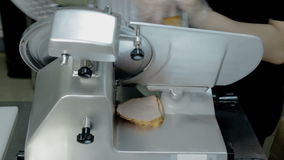 Close up shot slice machine cuts ham and meat stock footage
