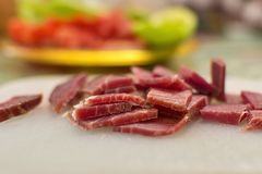 Sliced domestic ham on a kitchen table. Close up shot of sliced domestic ham on a kitchen table stock images