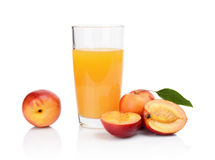 Close-up shot sliced nectarines with juice and leaf Royalty Free Stock Image