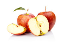 Close-up shot sliced red apple with leaf isolated Royalty Free Stock Photo