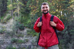 Smiling bearded hiker in mountains. Close-up shot of smiling bearded hiker in mountains, wearing hiking outfit Royalty Free Stock Images