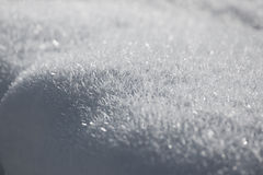 Close up shot of snow. Snowy ground with pretty christalline structure Stock Photography