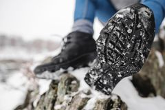 Sole of the trekking shoe with snow. Close Up shot of sole of the trekking boot with snow royalty free stock photo