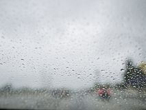 Close up shot of some water drops. With car, city as background at Los Angeles, California royalty free stock photo