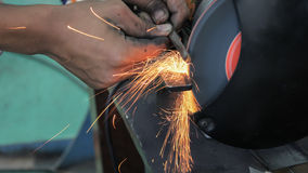 Close up shot of sparks from grinding wheel. Royalty Free Stock Photo