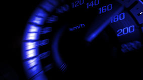 Close up shot of a speed meter in a car with blue light speed at 180 Km/H in concept racing car.  stock images