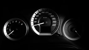 Close up shot of a speed meter in luxury car with dramatic light,low key Stock Photo