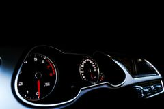 Close up shot of a speedometer in a car. Car dashboard. Dashboard details with indication lamps.Car instrument panel. Dashboard wi Royalty Free Stock Photography