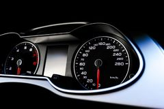 Close up shot of a speedometer in a car. Car dashboard. Dashboard details with indication lamps.Car instrument panel. Dashboard wi Stock Photos