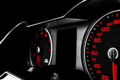 Close up shot of a speedometer in a car. Car dashboard. Dashboard details with indication lamps.Car instrument panel. Dashboard wi stock image