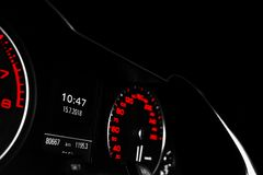 Close up shot of a speedometer in a car. Car dashboard. Dashboard details with indication lamps.Car instrument panel. Dashboard wi stock images