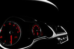Close up shot of a speedometer in a car. Car dashboard. Dashboard details with indication lamps.Car instrument panel. Dashboard wi. Th speedometer, tachometer stock image