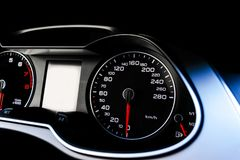 Close up shot of a speedometer in a car. Car dashboard. Dashboard details with indication lamps.Car instrument panel. Dashboard wi Stock Photo