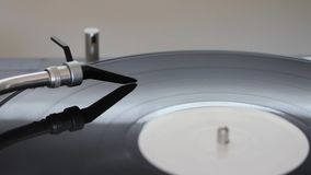 Close up shot of a spherical needle on a rotating vinyl.  stock footage