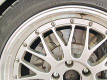 A close up shot of a sports car wheel and brakes Royalty Free Stock Photos